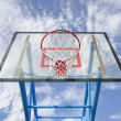 Stock Photo: Basketball hoop and blue sky