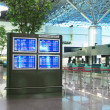 Flight schedule and check in counter — Stock Photo