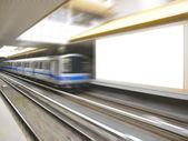 Blank billboard and moving train — Stock Photo