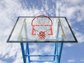Basketball hoop and blue sky — Stock Photo