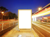 Blank billboard on sidewalk — Stock Photo