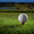 Golf ball on red tee — Stock Photo