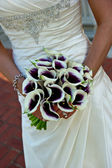 Closeup of a bride holding bouquet — Stock Photo