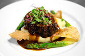 Gourmet filet on bed of mashed potatoes — Stock Photo