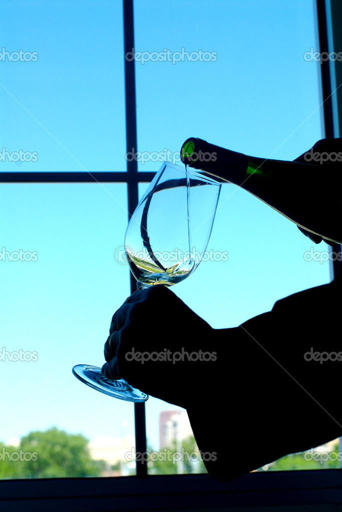 Image of wine being poured into a glass   Zdjcie stockowe #7096839