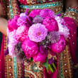 Indian brides hands holding bouquet — Stock Photo