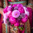 Indian brides hands holding bouquet — Stock Photo #7177938