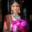 Stock Photo: Smiling Indian Bride with Bouquet