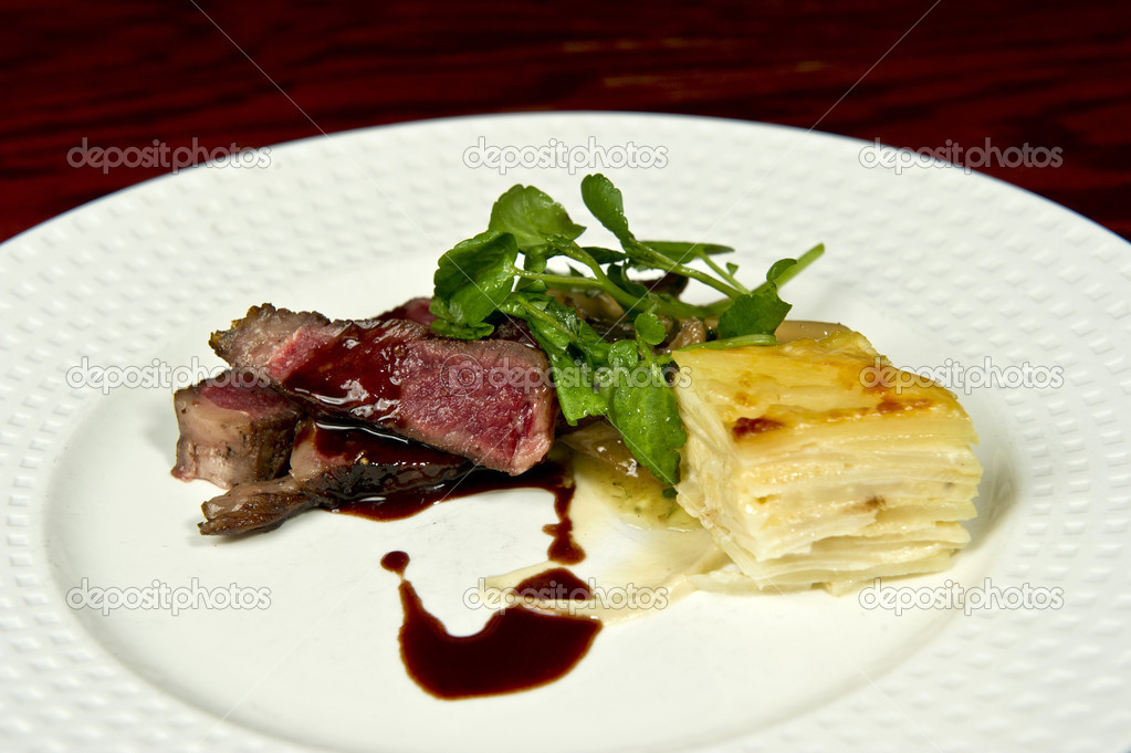 Image of a gourmet steak and potato dish — Stock Photo #7177917