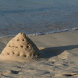Stock Photo: Precarious Sand Castle