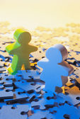 Wooden Figures on Jigsaw Puzzle Pieces — Stock Photo