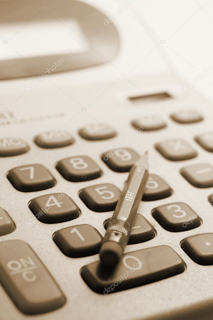 Pencil on Calculator in Sepia Tone — Stock Photo #6819764