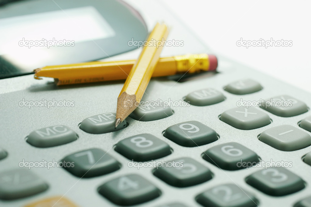 Snapped Pencils on Calculator in Green Cast  Stock Photo #6820200