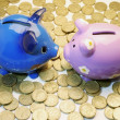 Piggy Banks and Coins — Stock Photo