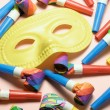 Face Mask and Party Blowers — ストック写真