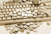 Coins on Computer Keyboard — Stock Photo