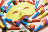 Face Mask and Party Blowers — Stock Photo