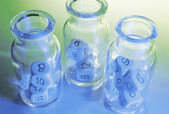 Bottles with Dice — Stock Photo