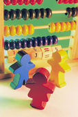 Wooden Figurines and Toy Abacus — Stock Photo