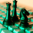 Chess Pieces on Computer Keyboard — Stock Photo