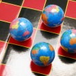 Globes on Game board — Stock Photo