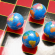 Stock Photo: Globes on Game board