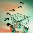 Shopping Trolley with Arrows - Stockfoto