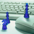 Stock Photo: Chess Pieces and Computer Keyboard
