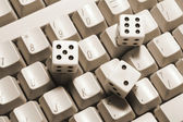 Dice on Keyboard — Stock Photo