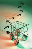 Shopping Trolley with Arrows — Stock Photo