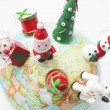 Christmas Ornaments on Globe - Stock Photo