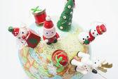 Christmas Ornaments on Globe — Stock Photo