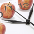 Clock and Apples - Stock Photo