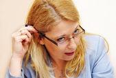 Businesswoman in glasses gesture — Stock Photo