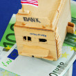 Wooden model of bank - Stock Photo