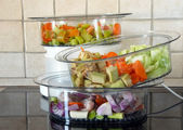 Colorful vegetables in steamer — Stock Photo