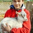 Royalty-Free Stock Photo: Teenage boy with little goat