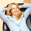 Businesswoman in glasses gesture — Stock Photo