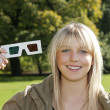 Young blond woman with 3D-glasses — Stock Photo