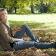Young woman sitting in the park — Stock Photo #7237296