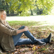Young woman sitting in the park — Stock Photo #7237304