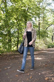 Young woman walking in the park — Stock Photo