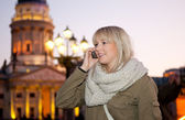 Teenager phoned in the city — Stock Photo