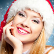 Stock Photo: Woman in Santa Claus hat