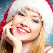 Woman in Santa Claus hat — Stock Photo