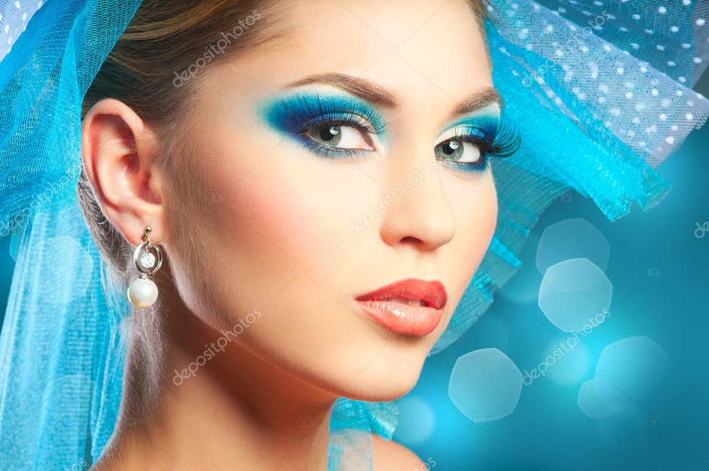 Portrait of young woman with blue make-up — Stock Photo #7806912