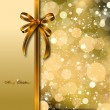 Royalty-Free Stock Vector Image: Gold bow on a magical Christmas card. Vector