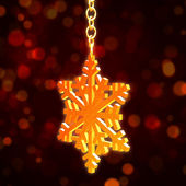 Golden Christmas snowflake over red background — Stock Photo