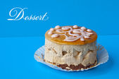Sweet cake on dark blue background — Stock Photo