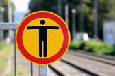 Railway passenger station stop sign — Stock Photo